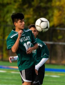 Wilby's Rodney Delgado (10) settles the ball during their NVL game against Sacred Heart Thursday at Municipal Stadium in Waterbury. Jim Shannon Republican-American