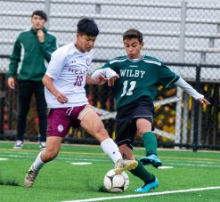Sacred Heart's Bill Nguyen (10) and Wilby's Nilton Miguel (11) fight for the ball during their NVL game Thursday at Municipal Stadium in Waterbury. Jim Shannon Republican-American