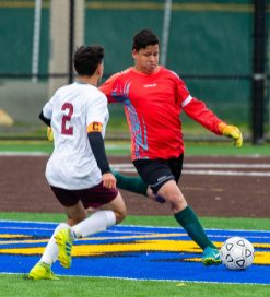 Wilby goal keeper Orlando Coello clears the ball while getting pressure from Sacred Heart's Eddy Romero (2) during their NVL game Thursday at Municipal Stadium in Waterbury. Jim Shannon Republican-American
