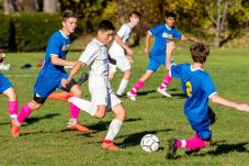 Housatonic Valley's Lucas Calhoun (10), center, takes a shot on goal in front of the sliding Gilbert defender Nate Fields (2), during a Boys BL soccer game between Housatonic Valley Regional and Gilbert at Walker Field in Winsted on Wednesday. Bill Shettle Republican-American