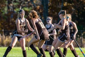 Thomston's Kristen Foell (10), left, celebrates her scoring of a goal with her teammates, during a girls BL field hockey match between Thomaston and Litchfield at Litchfield High School in Litchfield on Thursday. Bill Shettle Republican-American