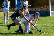 Litchfield's Elizabeth Southard (15), right, clears the ball falling down away from Thomaston's Arianna Komanaj (2), left, during a girls BL field hockey match between Thomaston and Litchfield at Litchfield High School in Litchfield on Thursday. Bill Shettle Republican-American