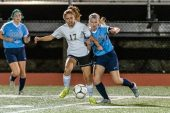 Woodland's Jillian O'Neil (17), tries to hold off Oxford's Maddie Sastram (9), right, during a girls NVL soccer match between Woodland Regional and Oxford at Oxford High School in Oxford on Thursday. Bill Shettle Republican-American