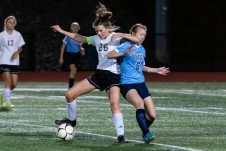 Woodland's Molly Hussey (26), left, holds off Oxford's Kate Wickenheisser (6) from getting to the ball, during a girls NVL soccer match between Woodland Regional and Oxford at Oxford High School in Oxford on Thursday. Bill Shettle Republican-American