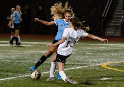 Oxford's Jess Kondic (8), controls the ball in front of a sliding Woodland defender Kaitlyn Leonard (13), during a girls NVL soccer match between Woodland Regional and Oxford at Oxford High School in Oxford on Thursday. Bill Shettle Republican-American