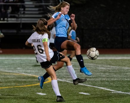 Oxford's Jess Kondic (8), right, charges in intercepting the ball in front of Woodland's Molly Hussey (26), during a girls NVL soccer match between Woodland Regional and Oxford at Oxford High School in Oxford on Thursday. Bill Shettle Republican-American