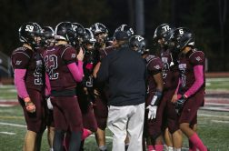 Torrington High School players huddle on the sideline during the boys varsity football game in Torrington against Wilby High School on Friday, Oct. 25, 2019. Emily J. Tilley. Republican-American