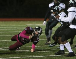 Torrington High School quarterback Conrad Avallone dives for an extra yard during the boys varsity football game in Torrington against Wilby High School on Friday, Oct. 25, 2019. Emily J. Tilley. Republican-American