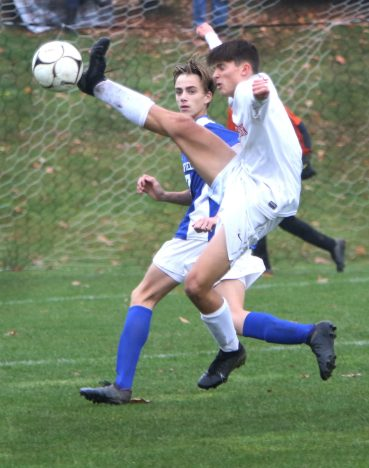 #8 Jacob Brodnitzki of Northwestern gets a ball past #17 Dan Dieck of Litchfield High during soccer action in Litchfield Tuesday. Steven Valenti Republican-American