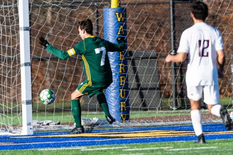 Holy Cross' Brian Silva (7) follows the ball into the goal after he headed it in for a score, during the quarterfinals of the Boys NVL Soccer Tournament between Torrington and Holy Cross at Municipal Stadium on Saturday. Bill Shettle Republican-American
