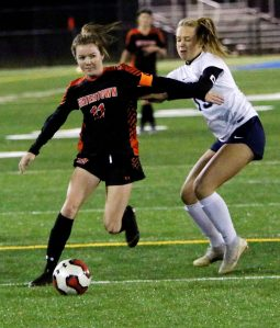 #11 Morgan Dodge of Watertown High takes a shot on goal as #13 Sage Borkowski of Oxford High defends during the NVL soccer tournament semifinals at Municipal Stadium in Waterbury Monday. Steven Valenti Republican-American