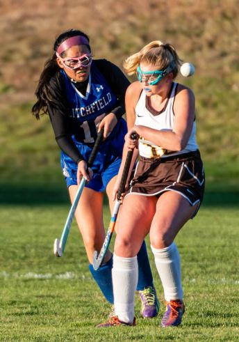 Litchfield's Marilyn Tiul (10), left, and Thomaston's Aurelia Barker (15) battle for the ball, during a BL girls field hockey match between Litchfield and Thomaston at Thomaston High School on Wednesday. The winner would have won the BL title but the match ended in a 2-2 tie. Bill Shettle Republican-American