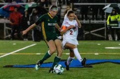 Holy Cross' Alyssa Hebb (16), left, clears the ball away from Watertown's Sophia Guerrera (2), during the NVL Girls Soccer final between Holy Cross and Watertown at Municipal Stadium on Thursday. Holy Cross came from two goals down to beat Watertown 3-2. Bill Shettle Republican-American
