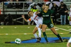 Watertown's Sophia Guerrera (2) and Holy Cross' Devon Bushka (13) battle for the ball, during the NVL Girls Soccer final between Holy Cross and Watertown at Municipal Stadium on Thursday. Holy Cross came from two goals down to beat Watertown 3-2. Bill Shettle Republican-American