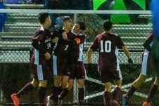 Naugatuck's Lucas Silva (7) is surrounded by his teammates after scoring a goal, during the NVL Boys Soccer final between Naugatuck and Woodland at Municipal Stadium in Waterbury on Thursday. The Naugatuck boys soccer team are the 2019 NVL Champions after beating Woodland 2-1. Bill Shettle Republican-American