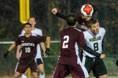 Woodland's Cole Barrows (8) heads the ball in between Naugatuck players Freddie Longo (3) and Bruno Silva (2), during the NVL Boys Soccer final between Naugatuck and Woodland at Municipal Stadium in Waterbury on Thursday. The Naugatuck boys soccer team are the 2019 NVL Champions after beating Woodland 2-1. Bill Shettle Republican-American