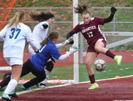 #17 Lilly Lyons of Naugatuck High tries to score against Rockville High during the first round of Class L girls soccer tournament in Naugatuck Tuesday. Steven Valenti Republican-American