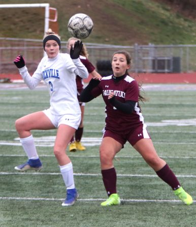 #3 Joanna Steed of Rockville High and #7 Noelle Jacobi of Naugatuck High try to control the ball during the first round of Class L girls soccer tournament in Naugatuck Tuesday. Steven Valenti Republican-American