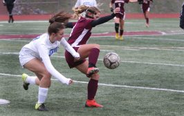 #4 Aalyiah Henry of Naugatuck High keeps the ball for #17 Carley Simler of Rockville High during the first round of Class L girls soccer tournament in Naugatuck Tuesday. Steven Valenti Republican-American