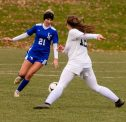 Litchfield's Camilla Seymour (21) makes a move and gets around Parish Hill's Elizabeth Sweat (12) during their second round match in the Class S girls soccer tournament Thursday at Plumb Hill Fields in Litchfield. Jim Shannon Republican-American