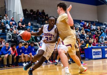 Crosby's Andre Pierre (35), left, dribbles towards the basket against Sacred Heart's Connor Tierney (0), during a NVL cross city Boys Basketball game between Sacred Heart and Crosby at the Palace at Crosby High in Waterbury on Friday. Bill Shettle Republican-American