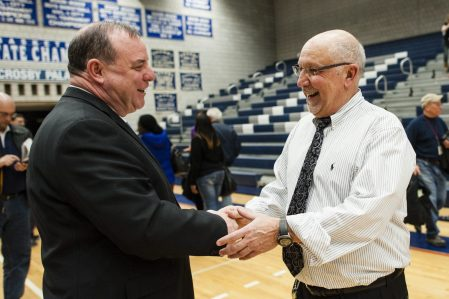 March 11, 2014: Crosby Coach Nick Augelli gets congratulations from Waterbury Mayor Neil O'Leary after Augelli's 600th win Tuesday night. The Bulldogs beat Manchester, 91-54. Erin Covey Republican-American