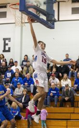 Nonnewaug #15 Aiden Colby puts up two un-oppossed against Gilbert during the Boys Berkshire League quarter final game at Shepaug Valley School Saturday afternoon. Jonathan Wilcox Republican-American