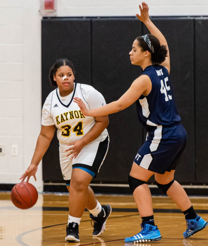 Kaynor Tech's Tasya Teasley (34) looks to pass while being guarded by Wolcott Tech's Abigail Williams (45) during their game Thursday at Kaynor Tech. Jim Shannon Republican-American