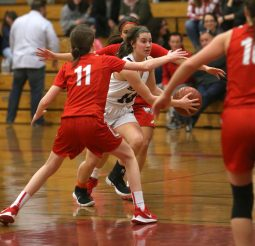 Torrington High School's Marissa Burger drives to the basket through Wolcott High School's Amanda Sullivan during the girls varsity basketball game on Thursday night, Feb. 13, 2020. Emily J. Tilley. Republican-American