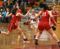 Torrington High School's Kate Mooney dribbles up the court through Wolcott High School's Alison LeClerc and Adriana Ferrucci during the girls varsity basketball game on Thursday night, Feb. 13, 2020. Emily J. Tilley. Republican-American