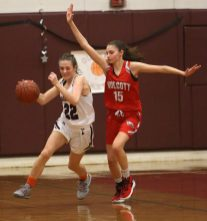 Torrington High School's Kate Mooney dribbles around Wolcott High School's Alison LeClerc during the girls varsity basketball game on Thursday night, Feb. 13, 2020. Emily J. Tilley. Republican-American