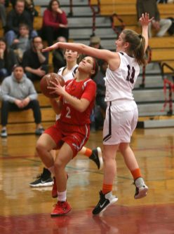Torrington High School's Suzie Navin tries to block a shot by Wolcott High School's Emiah Soto during the girls varsity basketball game on Thursday night, Feb. 13, 2020. Emily J. Tilley. Republican-American