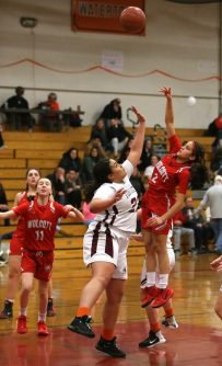 Wolcott High School's Emiah Soto goes up for a shot over Torrington High School's Ashley Davis during the girls varsity basketball game on Thursday night, Feb. 13, 2020. Emily J. Tilley. Republican-American