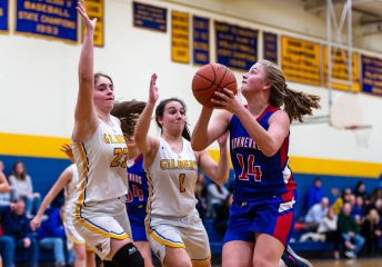 Nonnewaug's Madeline Roden (14), right, goes up for a shot against the double team defense of Gilbert's Ila Gutic(23), left, and Abbey Beecher (1) center, during a Girls BL basketball game between Nonnewaug and Gilbert at Gilbert High School on Thursday. Bill Shettle Republican-American