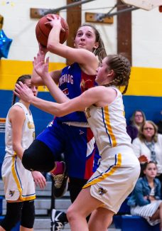 Nonnewaug's Ashley Hennessey (5), goes up for a shot against Gilbert's Kimberly McCarthy (4), during a Girls BL basketball game between Nonnewaug and Gilbert at Gilbert High School on Thursday. Bill Shettle Republican-American