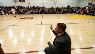 Sacred Heart's head coach Jon Carroll calls out to his players during their key NVL match-up with Naugatuck Friday at a sold-out Alumni Hall at Sacred Heart High School. Jim Shannon Republican-American