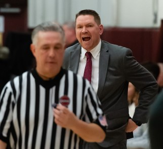 WATERBURY, CT-022120JS19- Sacred Heart head coach Jon Carroll argues a call with a referee during their key NVL match-up against Naugatuck Friday at Alumni Hall at Sacred Heart High School. Jim Shannon Republican-American