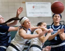 #21 Morgan Teododio and #2 Jacey Cosciello of Seymour battle for the rebound with #1 Jayda Sanchez of Ansonia High during the NVL Girls Basketball Tournament in Waterbury Saturday. Steven Valenti Republican-American