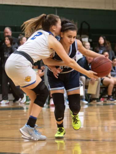 #14 Krystalee Fernandez of Ansonia High drive to the hoop past #2 Jacey Cosciello of Seymour High during the NVL Girls Basketball Tournament in Waterbury Saturday. Steven Valenti Republican-American
