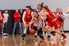 Nonnewaug's Samantha Conti (4), center, gets to a loose ball in between Northwestern players Natalie Lederman (22), left, and Skylar Dimartino (11), right, during the Girls Basketball Berkshire League finals between Nonnewaug and Northwestern at Northwest Regional High School in Winsted on Friday. Bill Shettle Republican-American