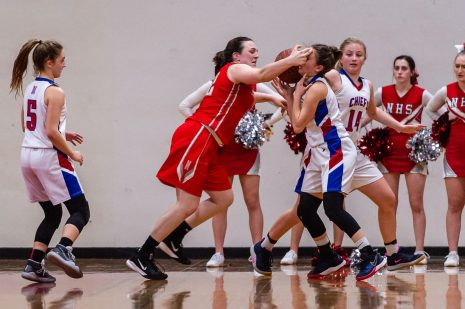 Northwestern's Natalie Lederman (22), center, hits Nonnewaug's Samantha Conti (4) in the face while stealing the ball away from her during the Girls Basketball Berkshire League finals between Nonnewaug and Northwestern at Northwest Regional High School in Winsted on Friday. Bill Shettle Republican-American