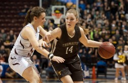 Thomaston's Morgan Sanson (14) drives past Canton's Katie Walker (11) during the Class S state championship Saturday at the Mohegan Sun Arena. Jim Shannon Republican-American