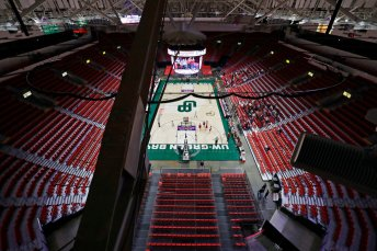 The stands are mostly empty as Arcadia High School plays against Platteville High School during their Division 3 semifinal game at the WIAA girls state basketball tournament Thursday, March 12, 2020, at the Resch Center in Ashwaubenon, Wis. Wisconsin Gov. Tony Evers declared a public health emergency, the state Capitol closed to formal tours and the state high school athletics association moved to drastically limit attendance at remaining winter tournaments Thursday as officials scrambled to prevent the further spread of the new coronavirus in Wisconsin. (Dan Powers/The Post-Crescent via AP)
