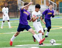 WATERBURY CT. - 23 October 2020-102320SV06-#11 Alvin Sabovic of Kennedy High and #10 Rodney Delgado of Wilby High battle for the ball during soccer action in Waterbury Friday. Steven Valenti Republican-American