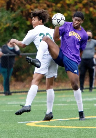 WATERBURY CT. - 23 October 2020-102320SV07-#8 Alain Latty of Kennedy High controls a ball as #30 Ruben Navarro of Wilby High defends during soccer action in Waterbury Friday. Steven Valenti Republican-American