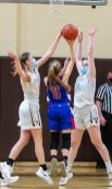 Nonnewaug's Ashley Hennessey (5) gets her shot blocked by Thomaston's Emma Kahn (1) while going to for a shot between Kahn and Sydney Eggleton (25) during their Berkshire League championship game Friday at Thomaston High School. Jim Shannon Republican American