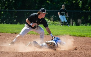 Woodland's Croy Mastropietro (14) tags out Bacon Academy's Harry Snow (7) as he tries to steal second base during their Class M baseball quarterfinal game Saturday at Woodland Regional High School. Jim Shannon Republican American
