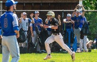 Woodland Jayden Tomasella (3) comes in to score on a double by Ryan Montini (4) during their Class M baseball quarterfinal game against Bacon Academy Saturday at Woodland Regional High School. Jim Shannon Republican American