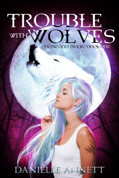 TROUBLE WITH WOLVES (Magic and Bone #1) by Danielle Annett
