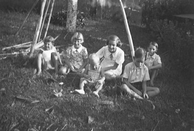 Family picnic, with my father on the far left.